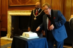 President cutting the cake